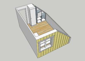 Platsbyggd bokhylla vid snedtak placerad med baksida mot vägg