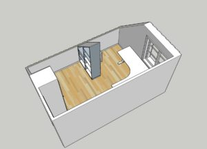 Platsbyggd bokhylla vid snedtak placerad som fristående rumsdelare mitt i rummet.